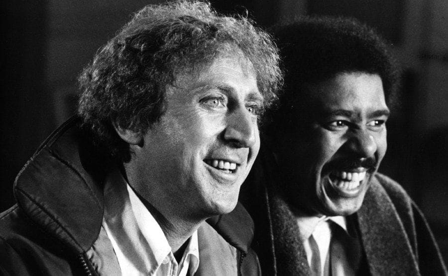 Gene Wilder and Richard Pryor laughing together on the set of Silver Streak