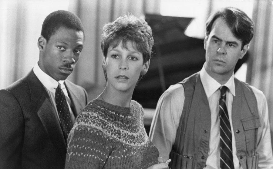 Eddie Murphy, Jamie Lee Curtis, and Dan Aykroyd in a scene from Trading Places