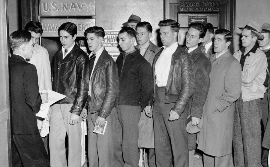 Shortly after the Japanese attack in Hawaii's Pearl Harbor, young men line up to volunteer at a Navy Recruiting Station, Boston, Massachusetts, December 8, 1941.
