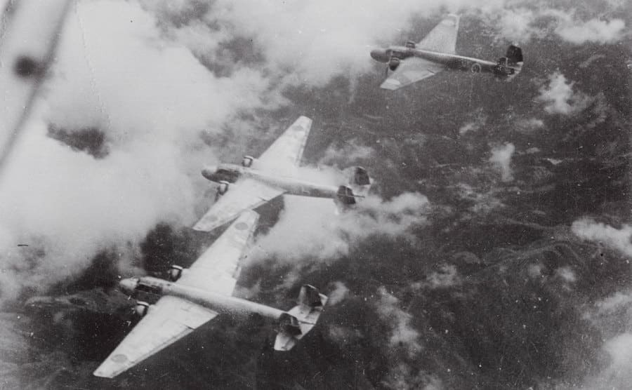 Japanese warplanes are flying in formation.