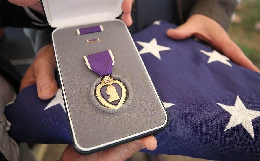 Someone is accepting the Purple Heart.