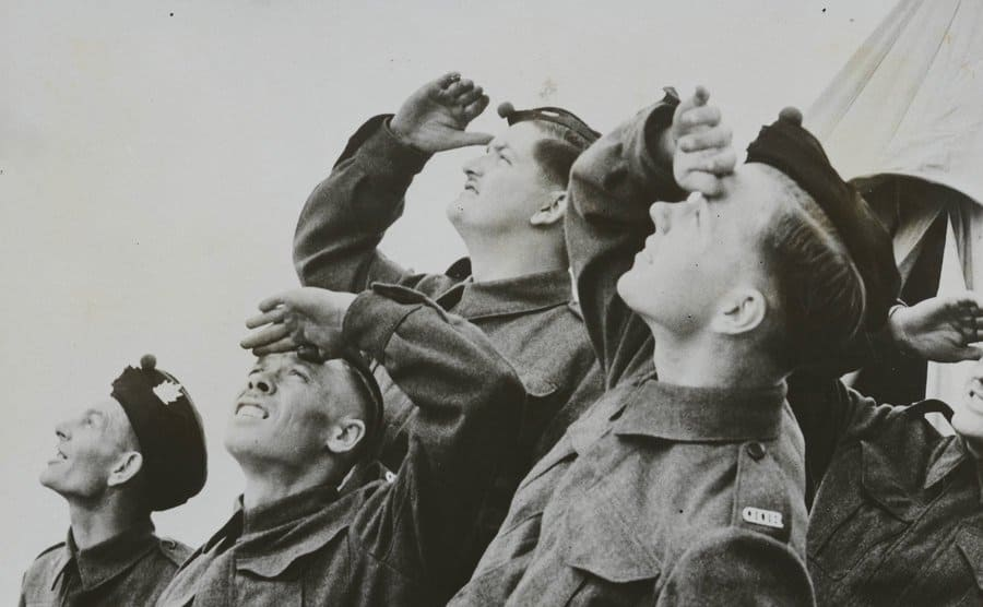 Land Recruits Watch Their Comrades In The Air.