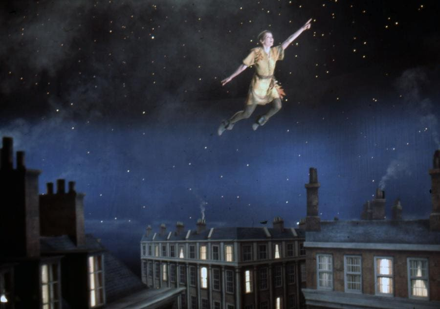 Mia Farrow as Peter Pan in the 1976 movie flying through the sky.