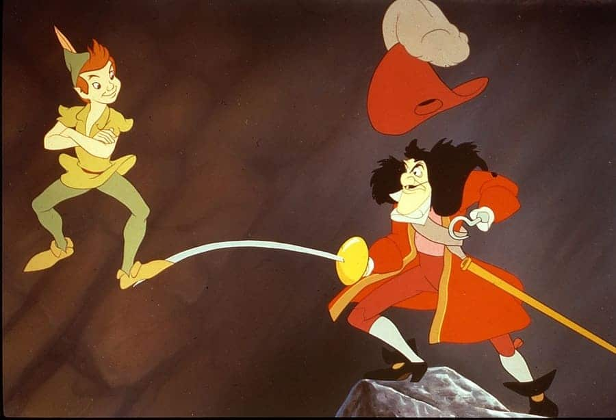Peter Pan was standing on Captain Hooks sword smugly in a scene from Disney's Peter Pan.
