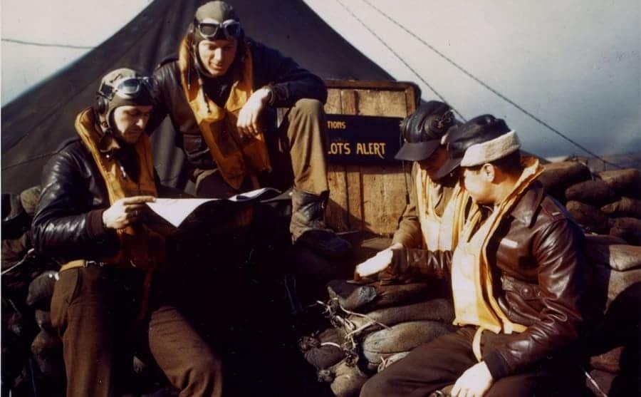 US pilots sitting around a tent
