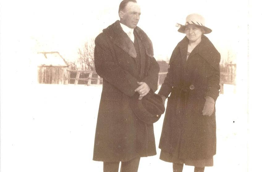 Charles and Etta Jones posing in a snow-covered field
