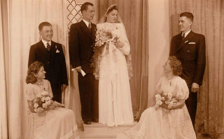 A vintage photograph of newlyweds and the bridesmaids