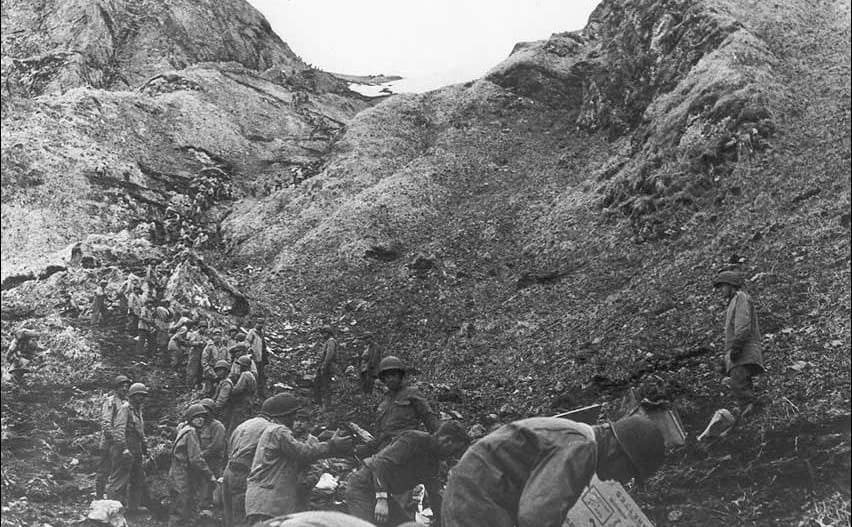 Soldiers walking up a mountain