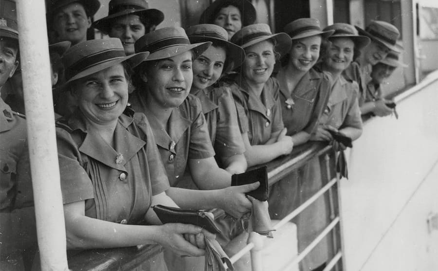 Australian nurses leaning over the side of a boat