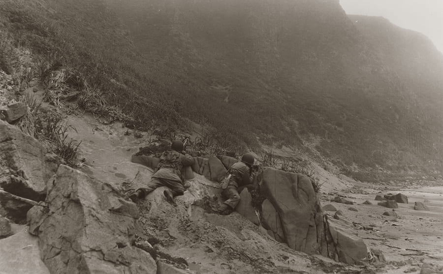 American troops on the side of a mountain during the battle of Attu