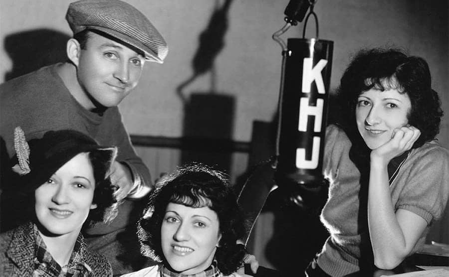 Bing Crosby and The Boswell Sisters at radio station KHJ sitting around a piano