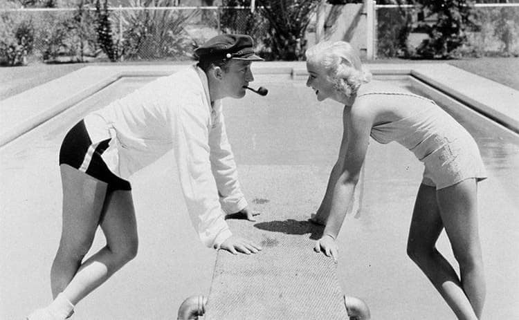 Bing Crosby and Dixie Lee Crosby at their home hanging out next to the pool circa 1935
