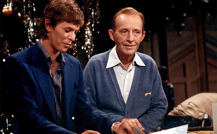 David Bowie and Bing Crosby sitting at a piano looking at sheet music in Bing Crosby's Merrie Olde Xmas 1977
