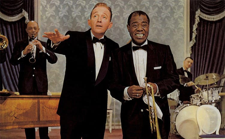 Bing Crosby and Louis Armstrong with their instruments on stage in the film High Society
