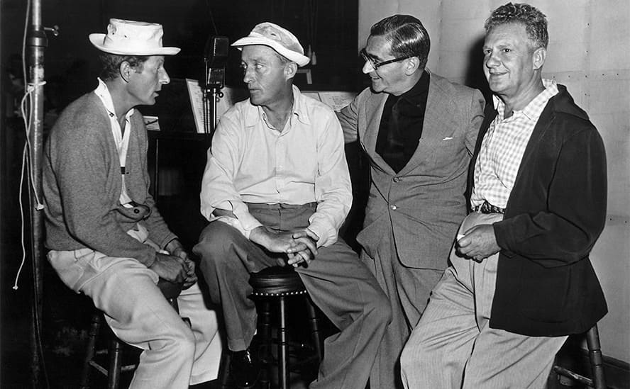 Danny Kaye, Bing Crosby, Irving Berlin, and Don Hartman on the set of White Christmas 1954