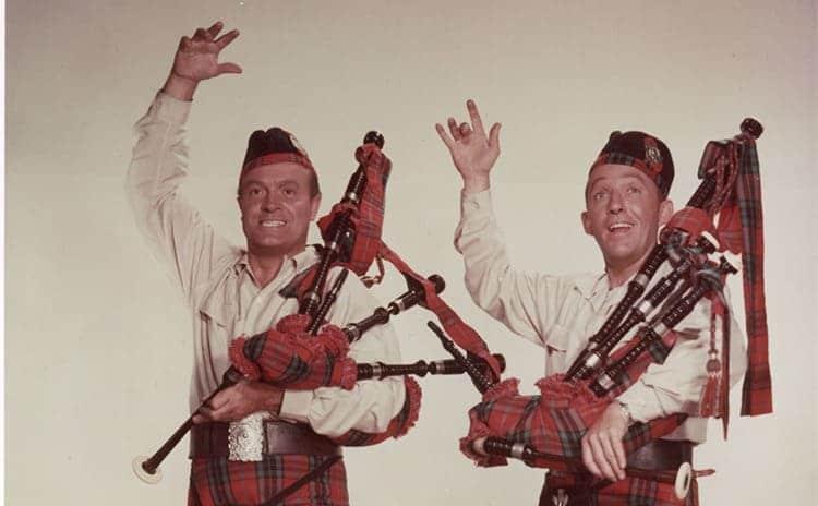 Bob Hope and Bing Crosby wearing kilts and holding bagpipes
