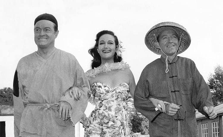 Bob Hope, Dorothy Lamour, and Bing Crosby walking around set of The Road to Hong Kong