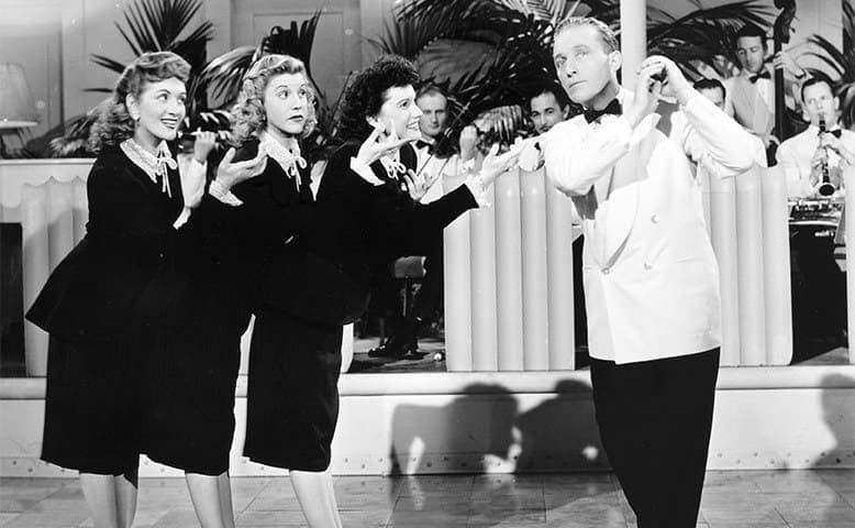 The Andrews Sisters and Bing Crosby performing in Road to Rio