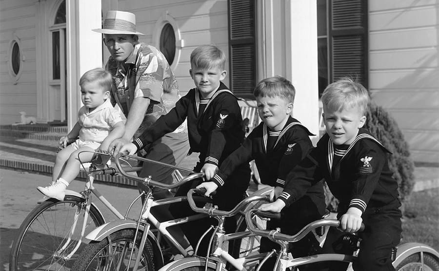 Bing Crosby with his four sons on bicycles