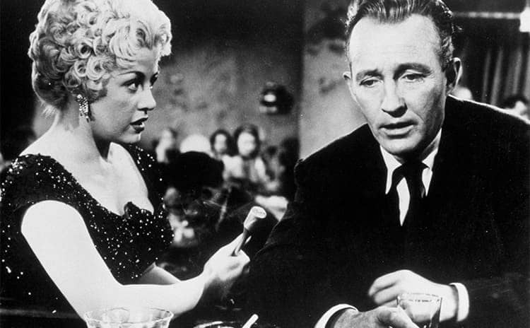 Jacqueline Fontaine and Bing Crosby sitting at a bar in The Country Girl 1954