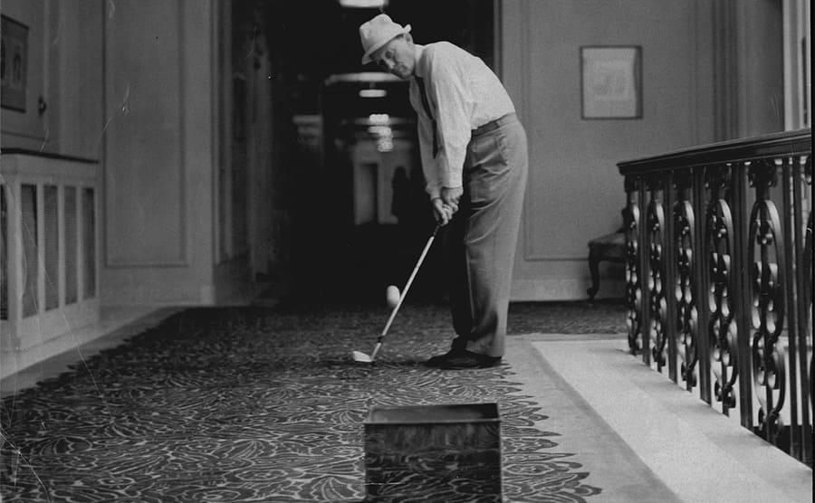 Bing Crosby playing indoor golf