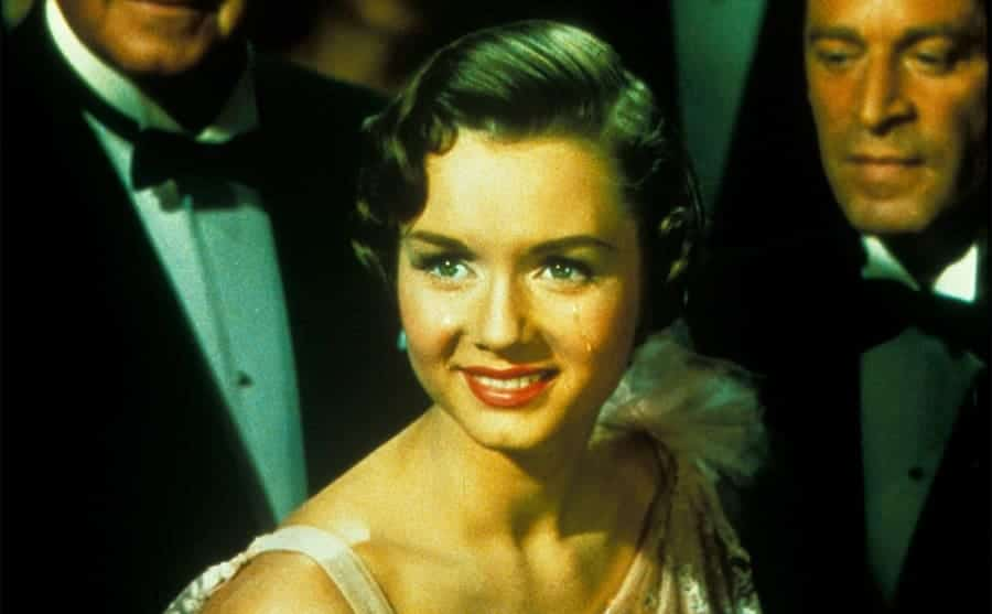Debbie Reynolds dressed up in Singing in the Rain