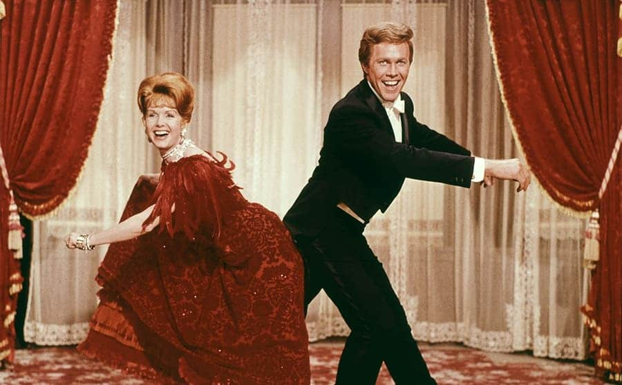 Debbie Reynolds and Harve Presnell dancing together in the film The Unsinkable Molly Brown