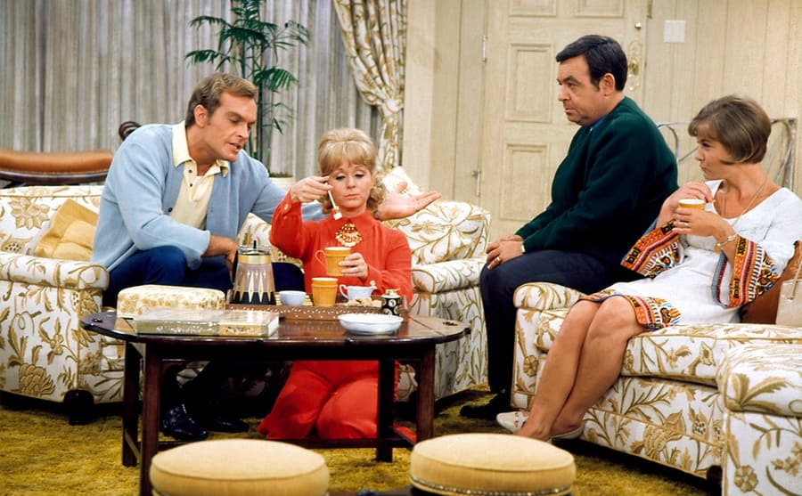Don Chastain, Debbie Reynolds, Tom Bosley, and Patricia Smith sitting on couches in the living room on the Debbie Reynolds Show