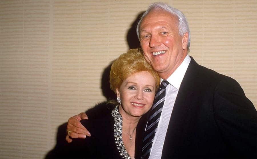 Debbie Reynolds posing with Richard Hamlett