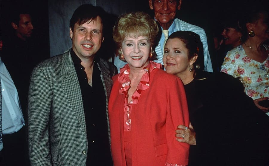 Todd Fisher, Debbie Reynolds, and Carrie Fisher at an event in 1998