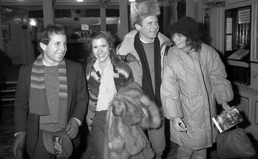 Paul Simon, Carrie Fisher, Art Garfunkel, and Penny Marshall at the theater in 1982