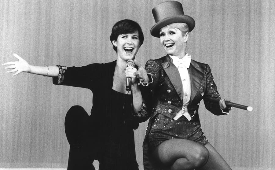 Carrie Fisher and Debbie Reynolds performing on stage
