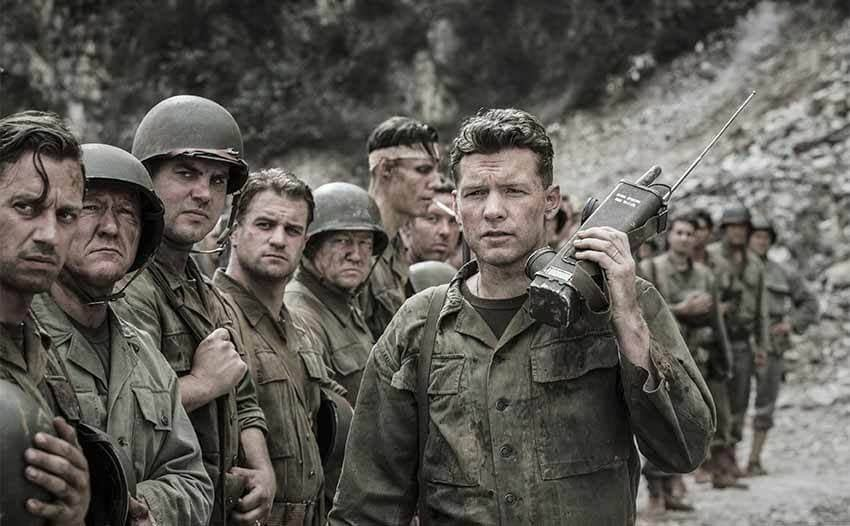 Sam Worthington with a line of soldiers in a scene from Hacksaw Ridge