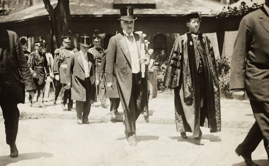 JP Morgan Sr walking in the Harvard Commencement Parade with the Dean to his left