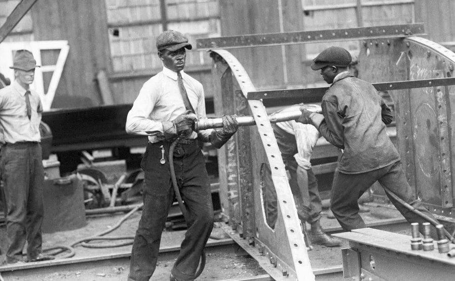 Men hard at work with steel beams