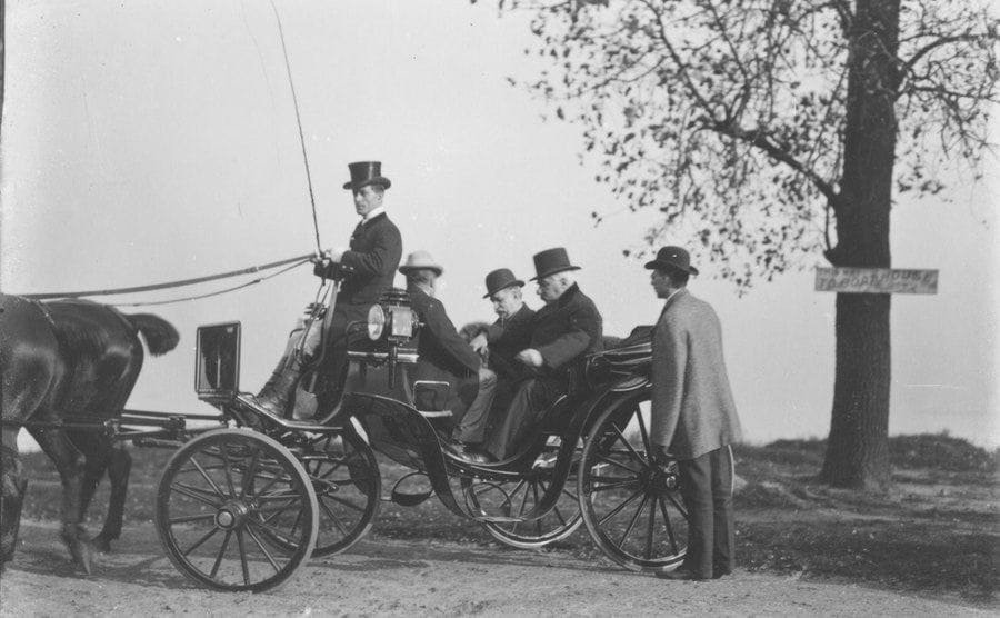 JP Morgan sitting in a horse-drawn carriage