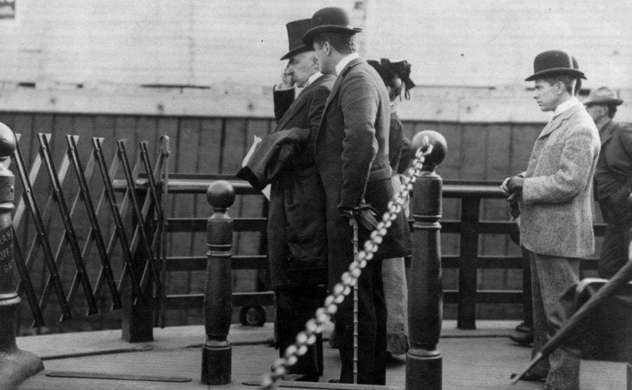 JP Morgan walking on the pier with other important-looking men