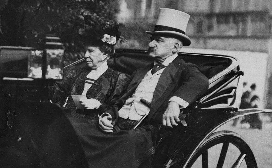 JP Morgan sitting in a carriage with his wife
