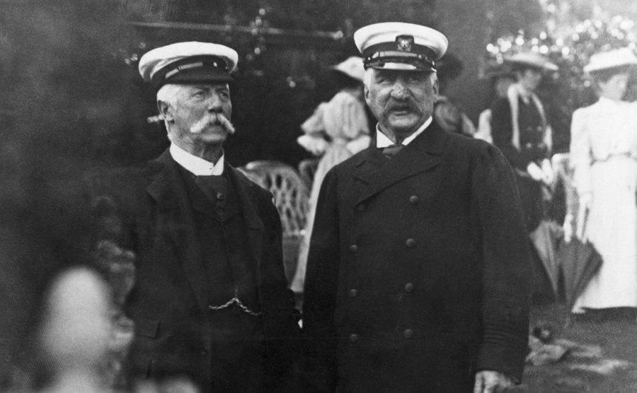 JP Morgan and Thomas Lipton posing together in captains hats
