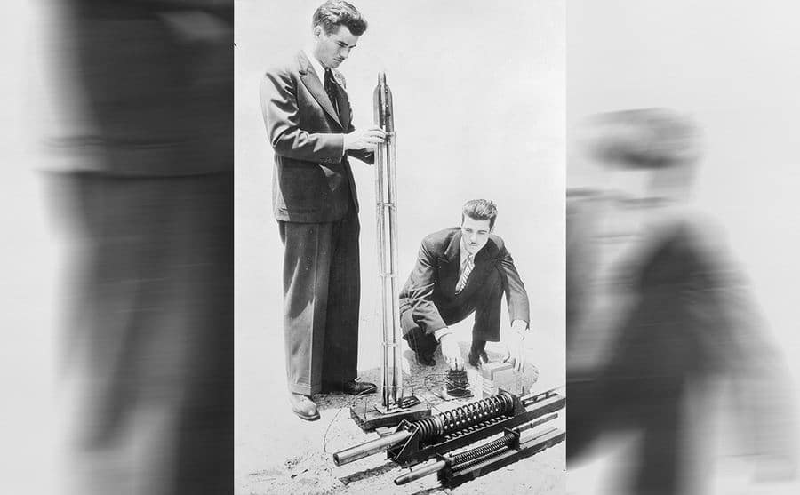 Jack Parsons and another man working on a rocket