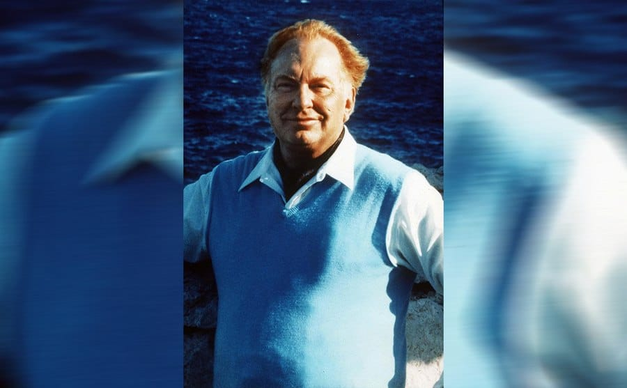L Ron Hubbard standing in front of an ocean