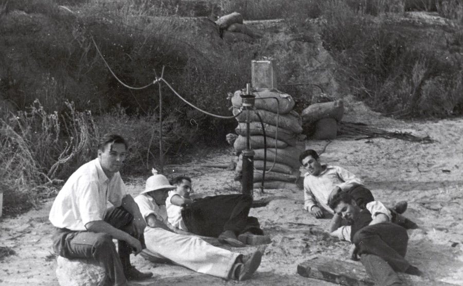 Frank Malina, Ed Forman, and Jack Parsons with two colleagues in 1936 sitting in a dirty field