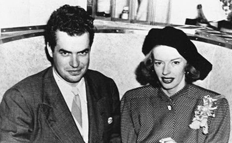 Jack Parsons and Marjorie Cameron sitting at a table