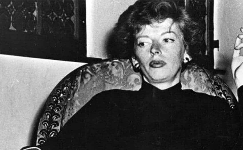 Marjorie Cameron sitting in a fancy armchair