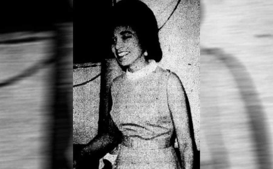 Jannie Duncan standing in a nice dress