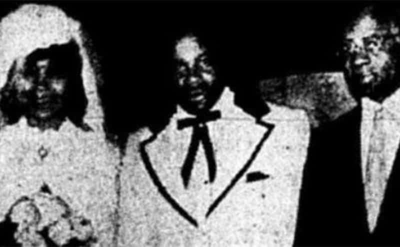 Jannie as a bride standing with her husband