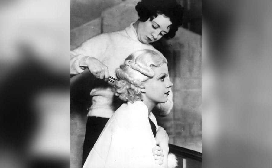 Jean Harlow, American film actress, having her famous platinum blonde hair set.