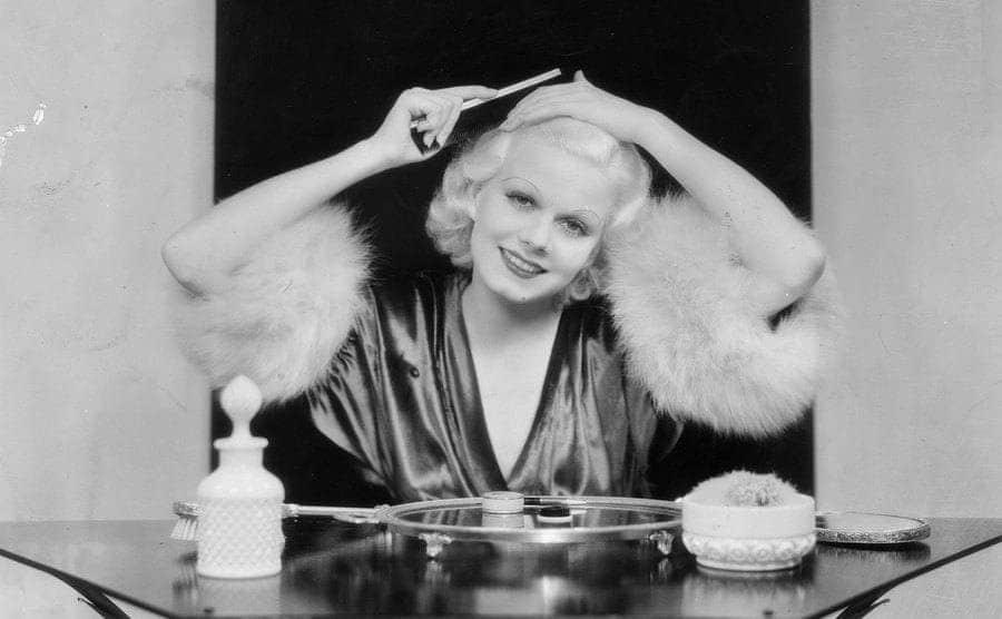 The sensual Metro-Goldwyn-Meyer film actress Jean Harlow, at her make-up table.