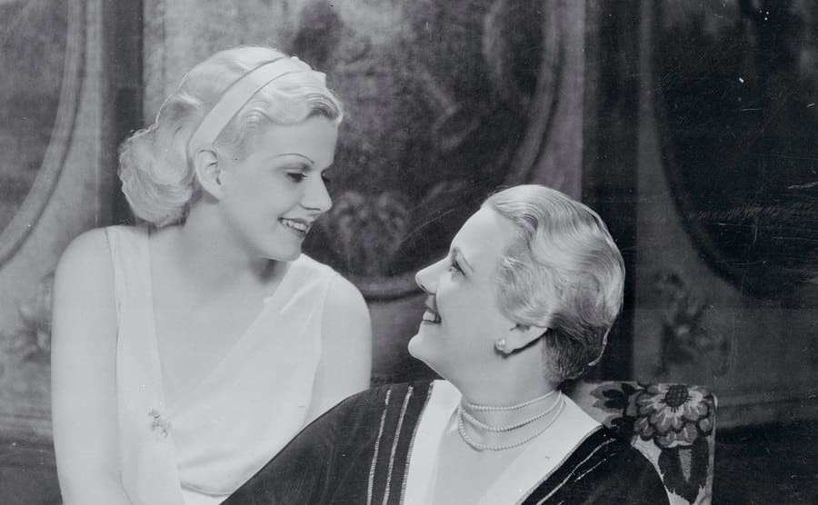 Film actress Jean Harlow and her mother Jean Bello stare lovingly at each other.