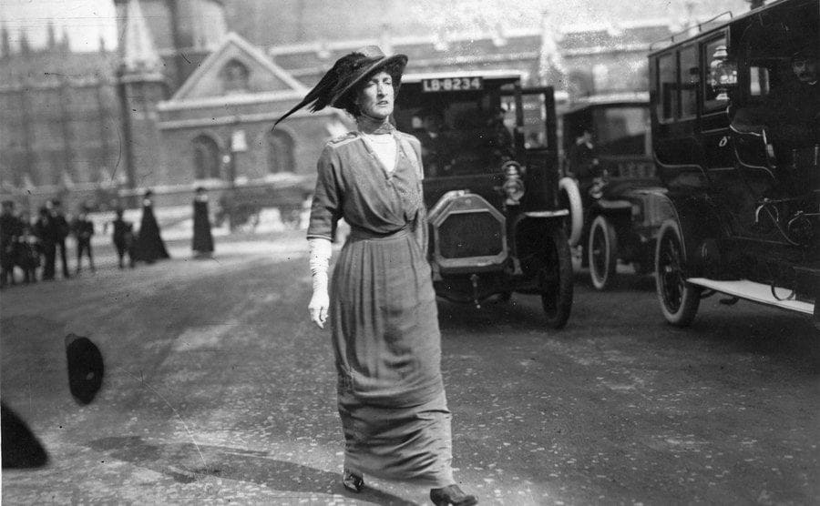 Margot, later Countess of Oxford & Asquith, second wife of the British Liberal statesman and prime minister Herbert Henry Asquith, walking down the street.